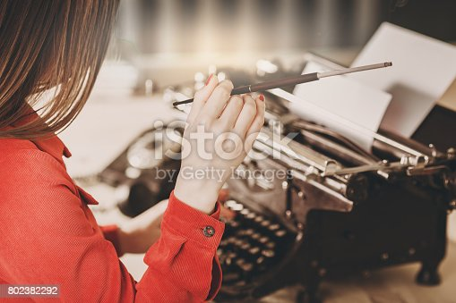 istock Young woman using typewriter. Business concepts. Retro picture style. 802382292