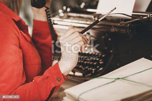 istock Young woman using typewriter. Business concepts. Retro picture style. 802382302
