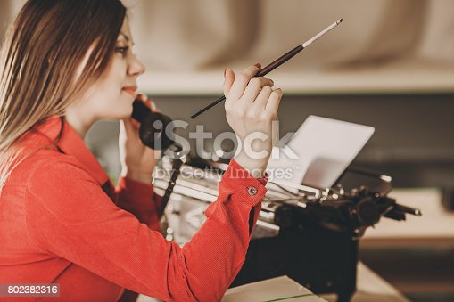 istock Young woman using typewriter. Business concepts. Retro picture style. 802382316