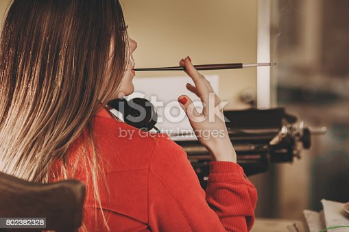istock Young woman using typewriter. Business concepts. Retro picture style. 802382328