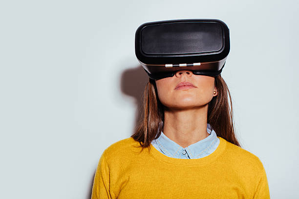 Young woman using virtual reality glasses stock photo
