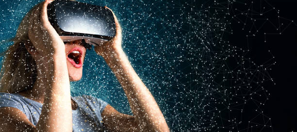 Young woman using virtual reality headset stock photo