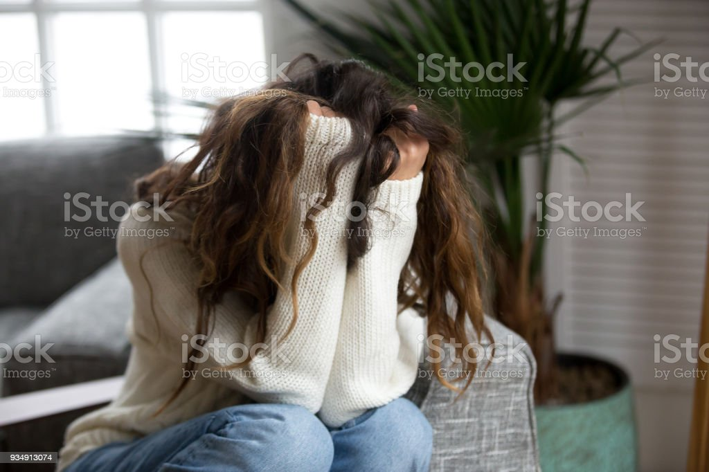 Young woman victim suffering from abuse, harassment, depression or heartbreak stock photo
