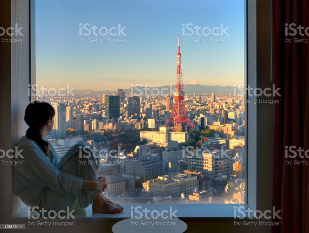 Young Woman Viewing Tokyo at Sunrise stock photo