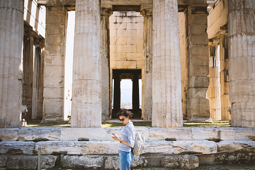 Young woman visiting Ancient Agora of Athens