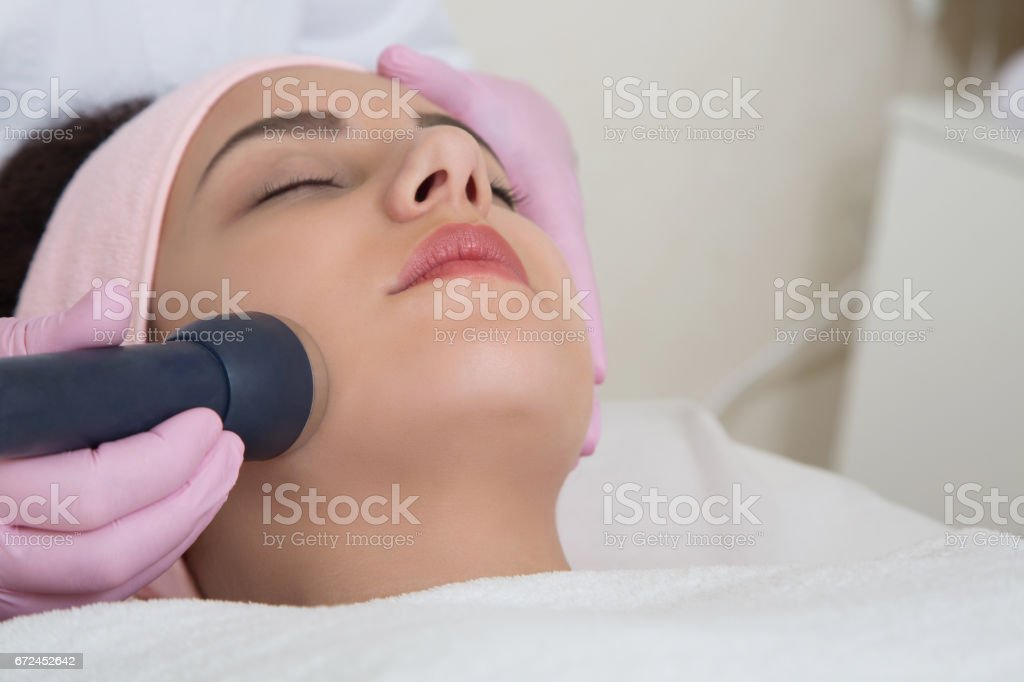 Young woman visiting cosmetologist stock photo