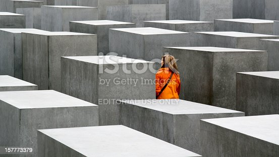 istock Young woman visiting the Holocaust Memorial in Berlin, Germany 157773379