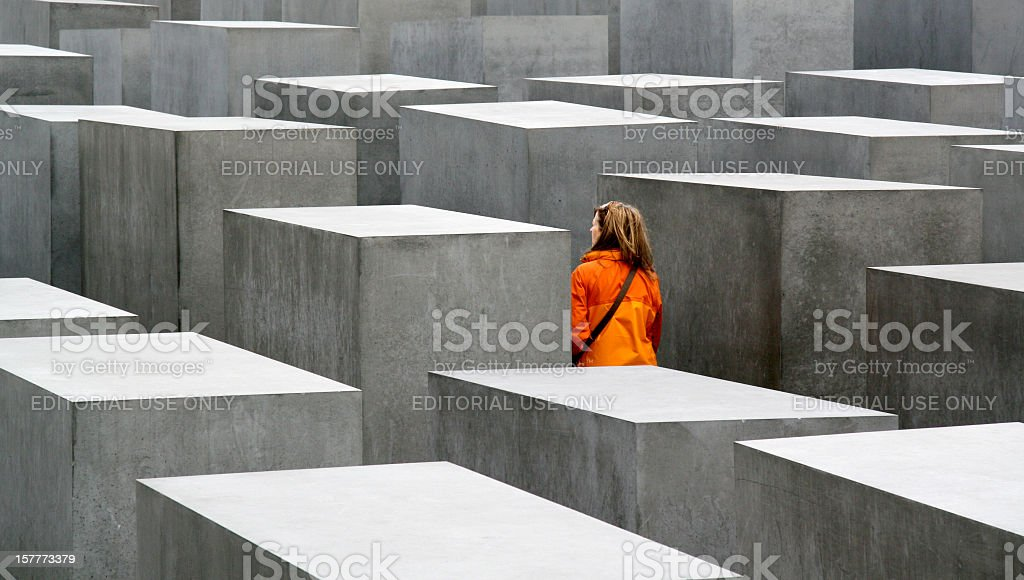 Young woman visiting the Holocaust Memorial in Berlin, Germany stock photo