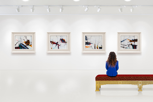 Young Woman Visits An Art Gallery Stock Photo - Download Image Now