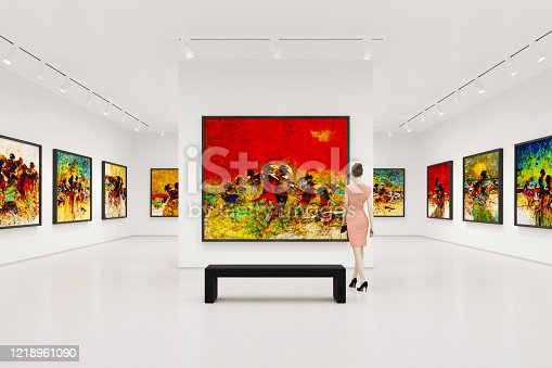 Young woman visits art exhibition and looking at the fine art paintings in a art gallery.