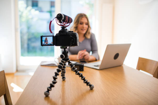 young woman vlogger - vlogger stock photos and pictures