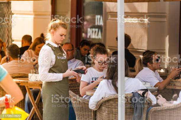 Young woman waiter takes an order in a street cafe pizzeria picture id1173522522?b=1&k=6&m=1173522522&s=612x612&h=zx1kmb9lywgep8vvw9zjn2hrcbuv i2dtyux8fjoxdi=
