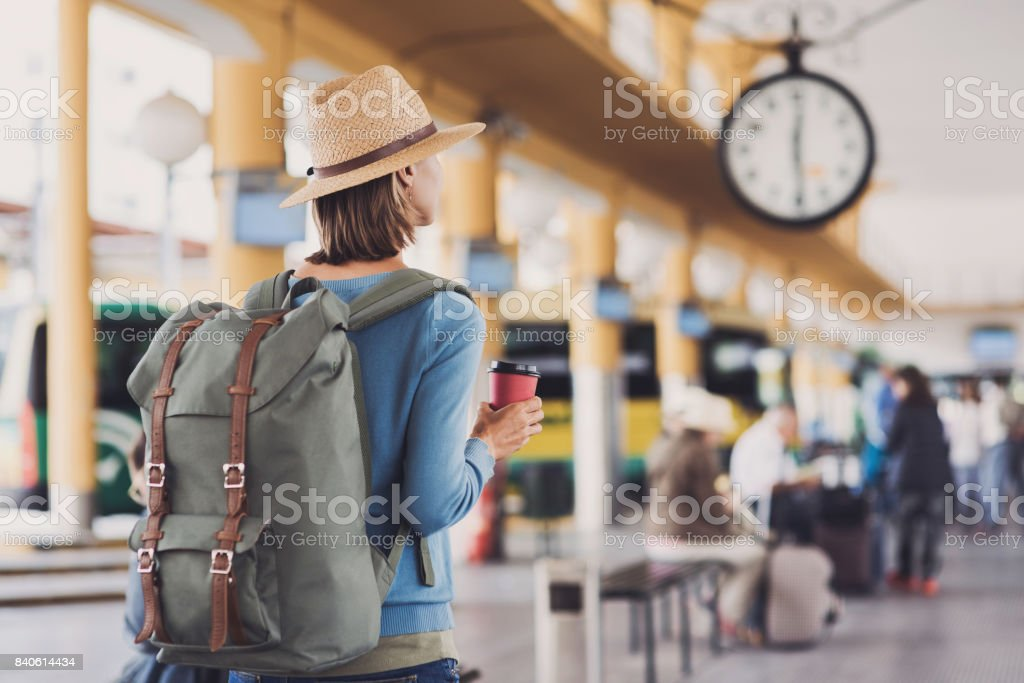 Young woman waiting for a bus. Travel concept - foto stock