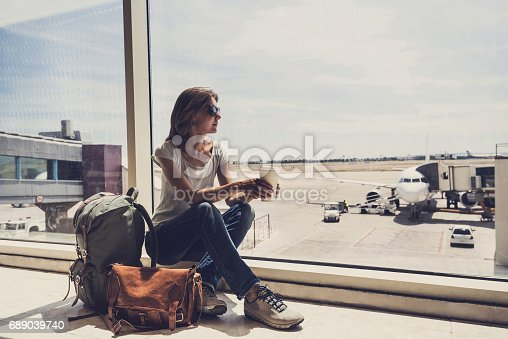 istock Young woman waiting for a plane. Travel concept 689039740