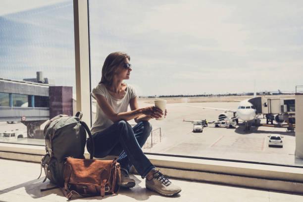Young woman waiting for a plane. Travel concept - fotografia de stock