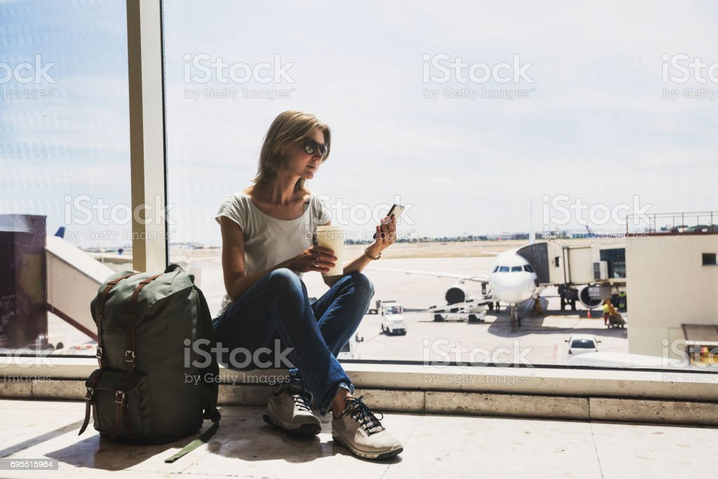 Young woman waiting for a plane. Travel concept stock photo