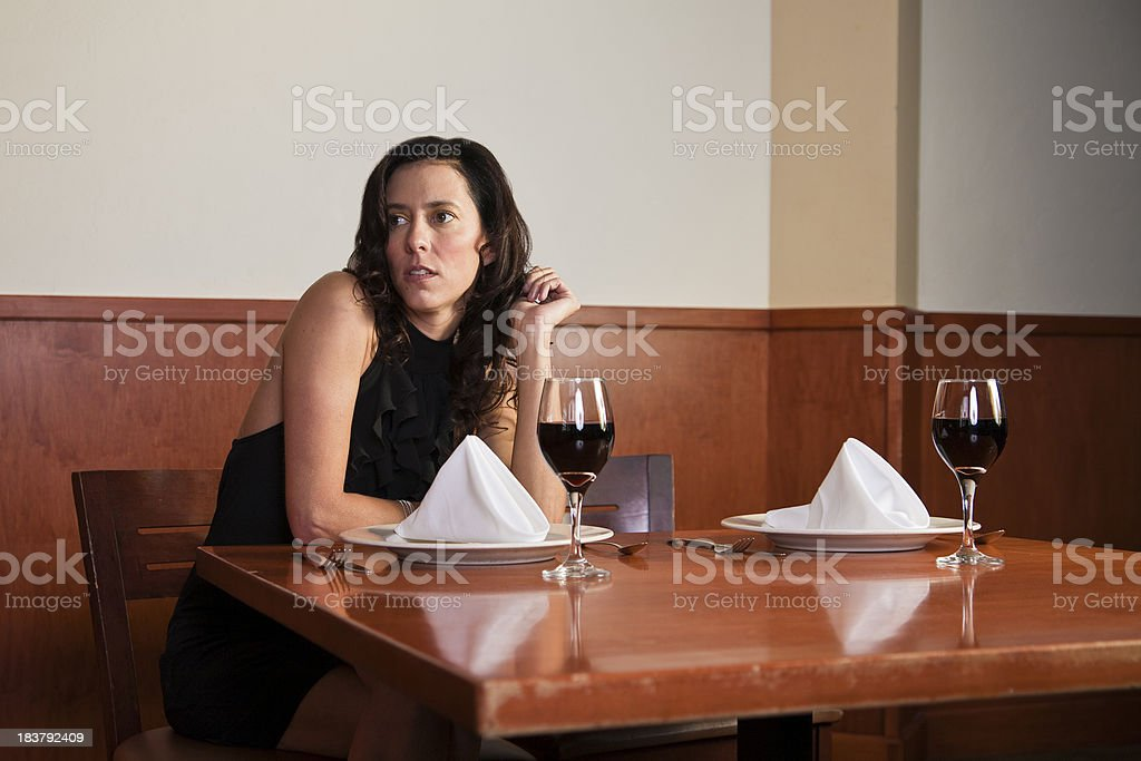 Young woman waiting for her date stock photo