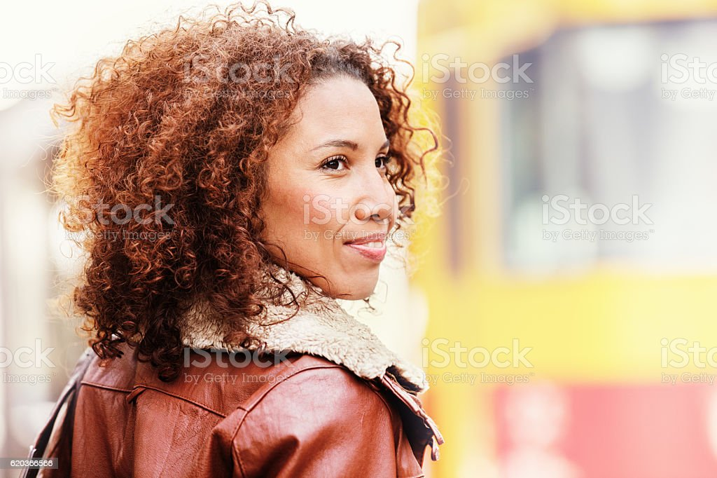 Young woman waiting for the bus. zbiór zdjęć royalty-free