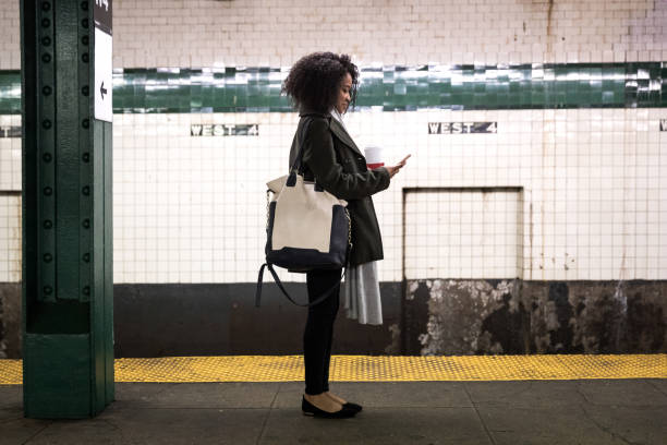 Young woman waiting for the subway train in New York Young woman waiting for the subway train in New York, USA. underground stock pictures, royalty-free photos & images