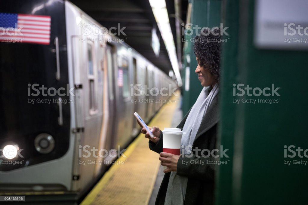 Young woman waiting for the subway train in New York stock photo