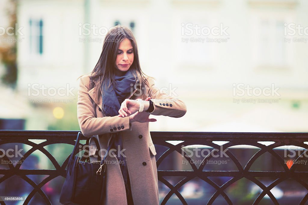 Young woman waiting on a blind date stock photo