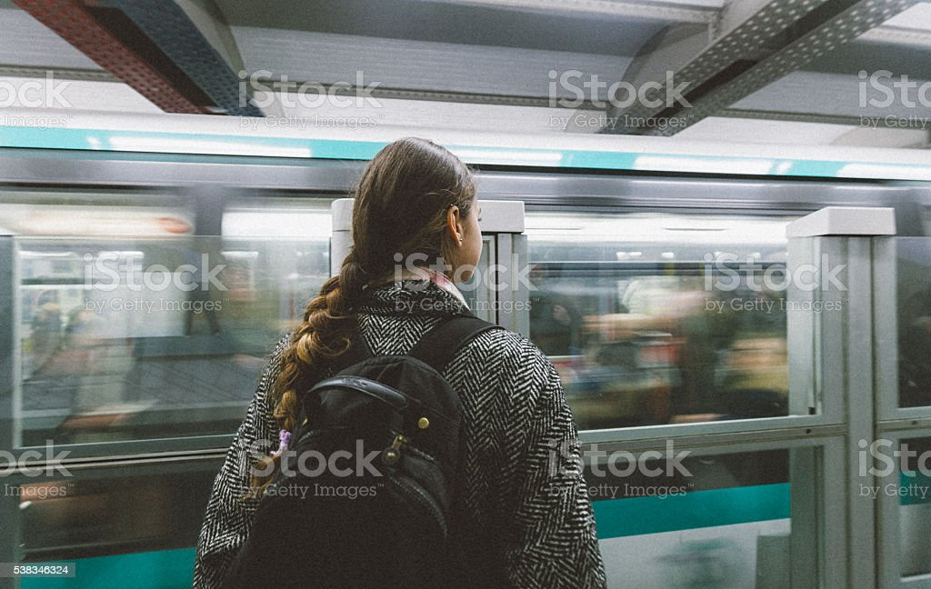 Young woman waiting the train in paris subway station stock photo