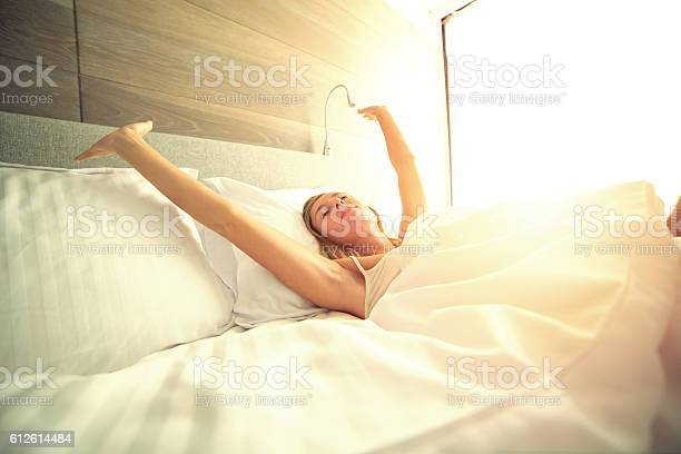Young woman waking up in her hotel room stretching arms picture id612614484?b=1&k=6&m=612614484&s=612x612&h=meyaa8cptcwdiyj9yvxmqxm3zl7nzcbvguyp7q3x0ew=