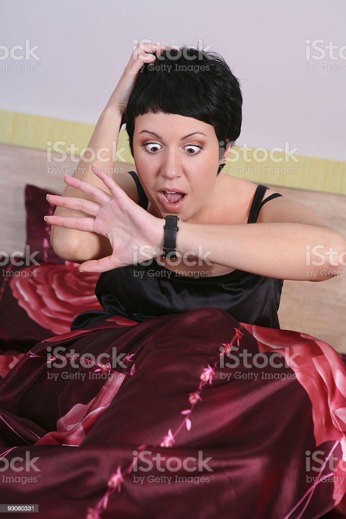 Young woman waking up in the morning royalty-free stock photo
