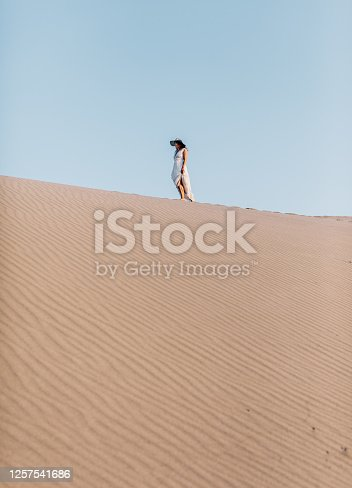 istock Young woman walkin on the sand hills of Patara, Antalya, Turkey 1257541686