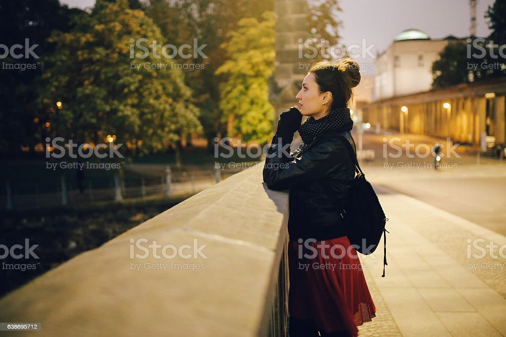 Young woman walking and relaxing in Berlin Mitte at night stock photo