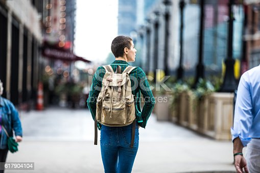 istock Young woman walking for shopping in downtown Chicago 617904104