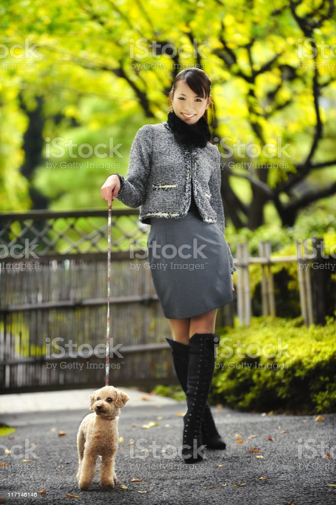 Young woman walking her dog royalty-free stock photo