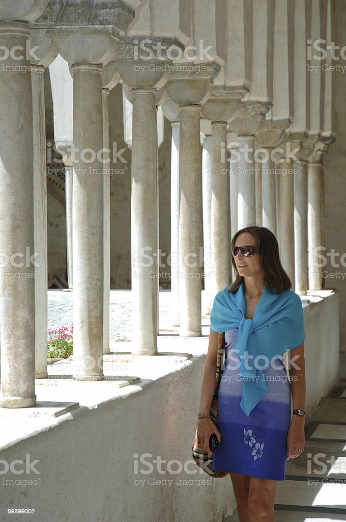 young woman walking in a cloisters royalty-free stock photo