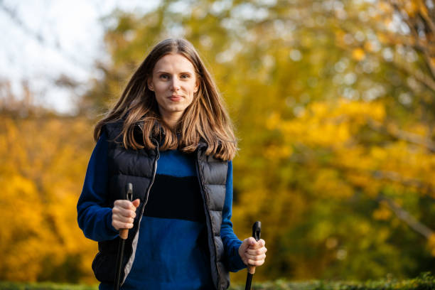 Young woman walking in city park People walking in city park nordic walking stock pictures, royalty-free photos & images