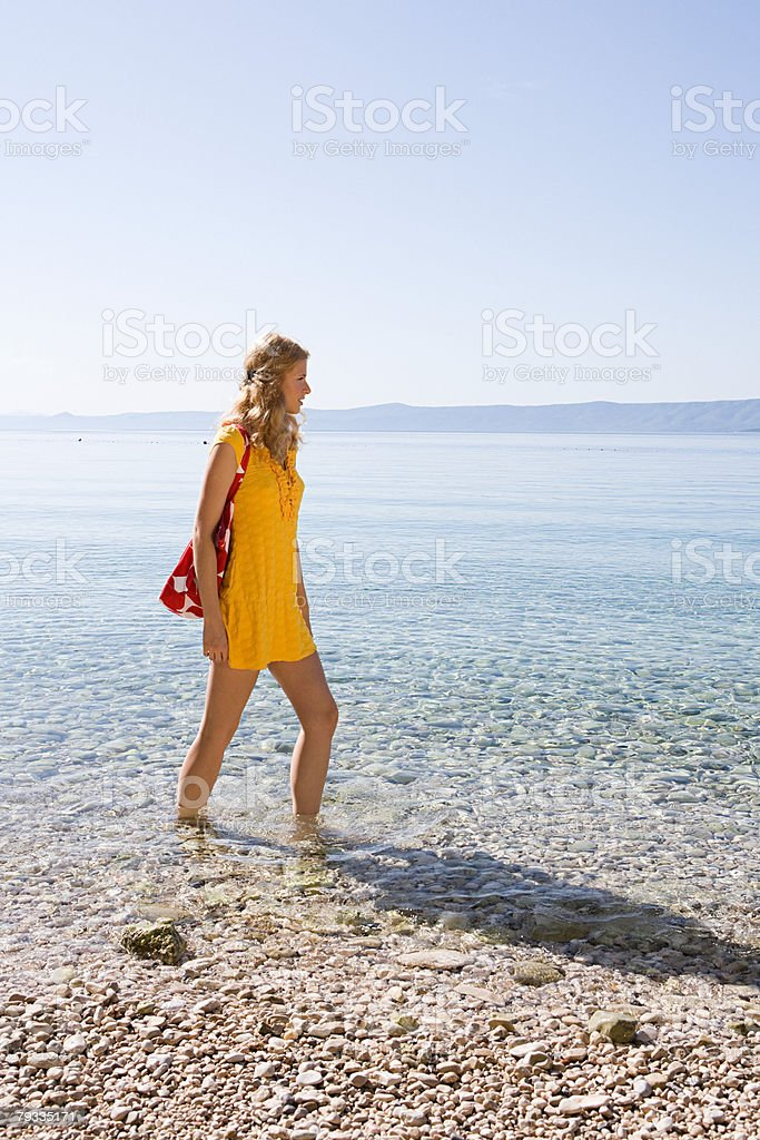 Young woman walking in sea royalty-free stock photo
