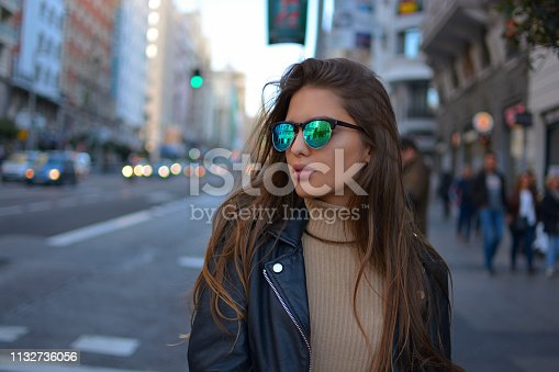 istock young woman walking in te city 1132736056