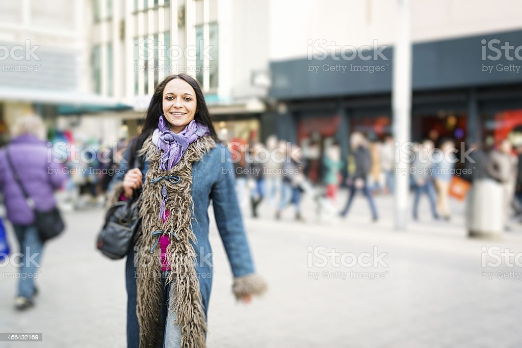young woman walking in the city royalty-free stock photo