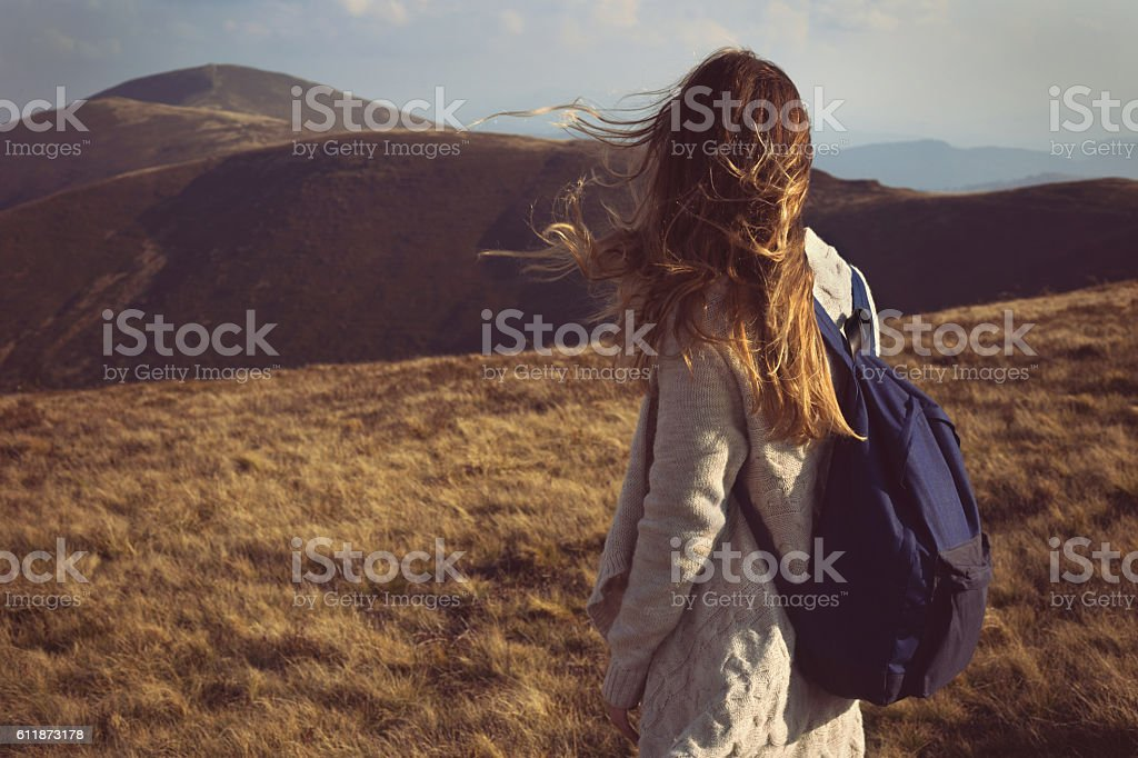 Young woman walking in the nature stock photo