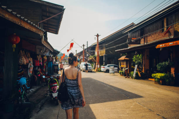Young woman walking in the Old Town of the Koh Lanta island, Thailand stock photo