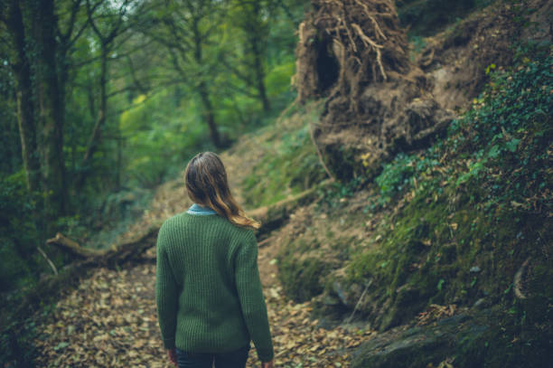 Young woman walking in the woods stock photo