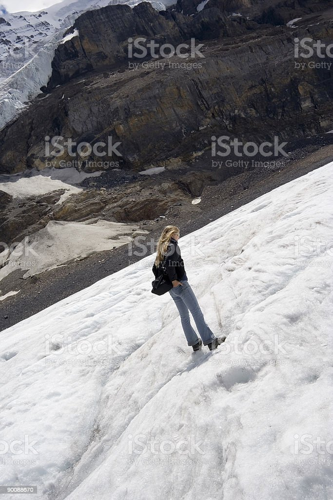 young woman walking on a glacier royalty-free stock photo