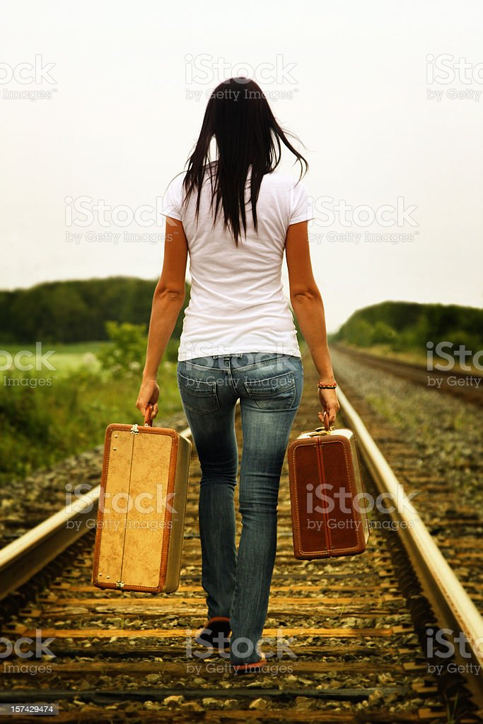 Young woman walking on a railroad track royalty-free stock photo