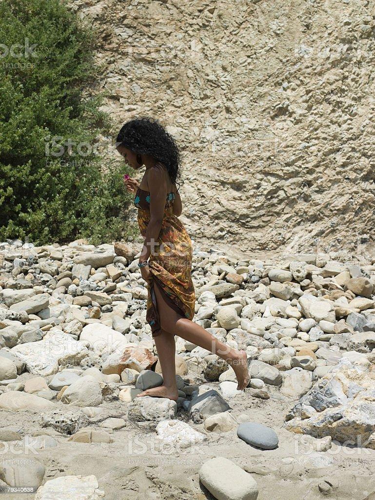 Young woman walking on rocks 免版稅 stock photo
