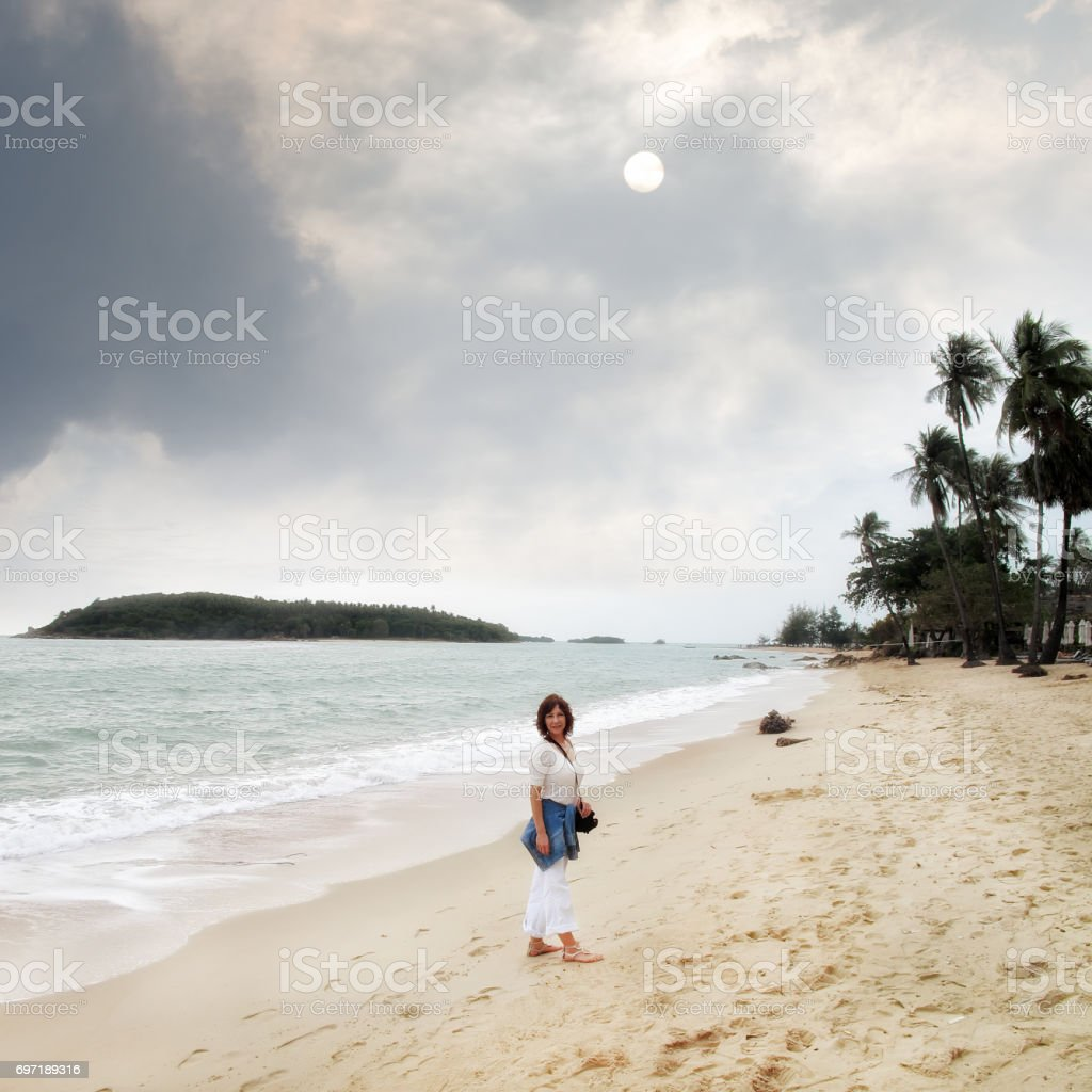 Woman walking on a beach royalty - Young Woman Walking On Sandy Beach Royalty Free Stock Photo