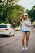 istock Young woman walking on the street in summer 1283498725