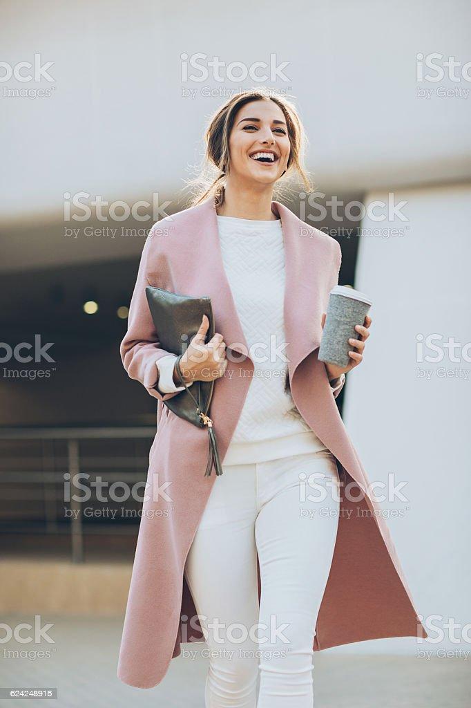 Young woman walking outdoors stock photo