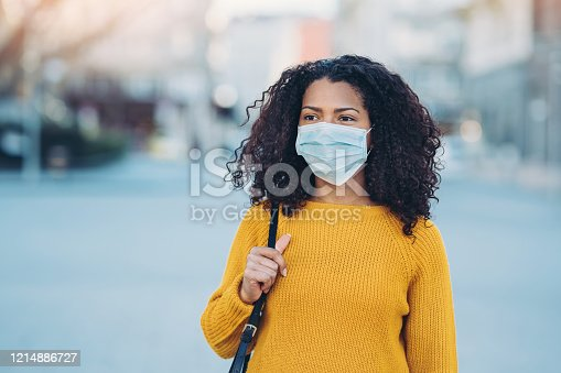 Woman wearing a face mask walking outdoors