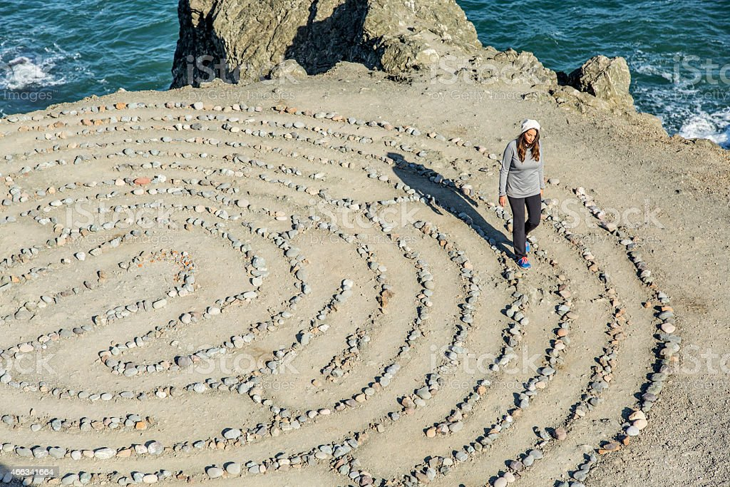 Young Woman Walking the Land's End Labyrinth stock photo