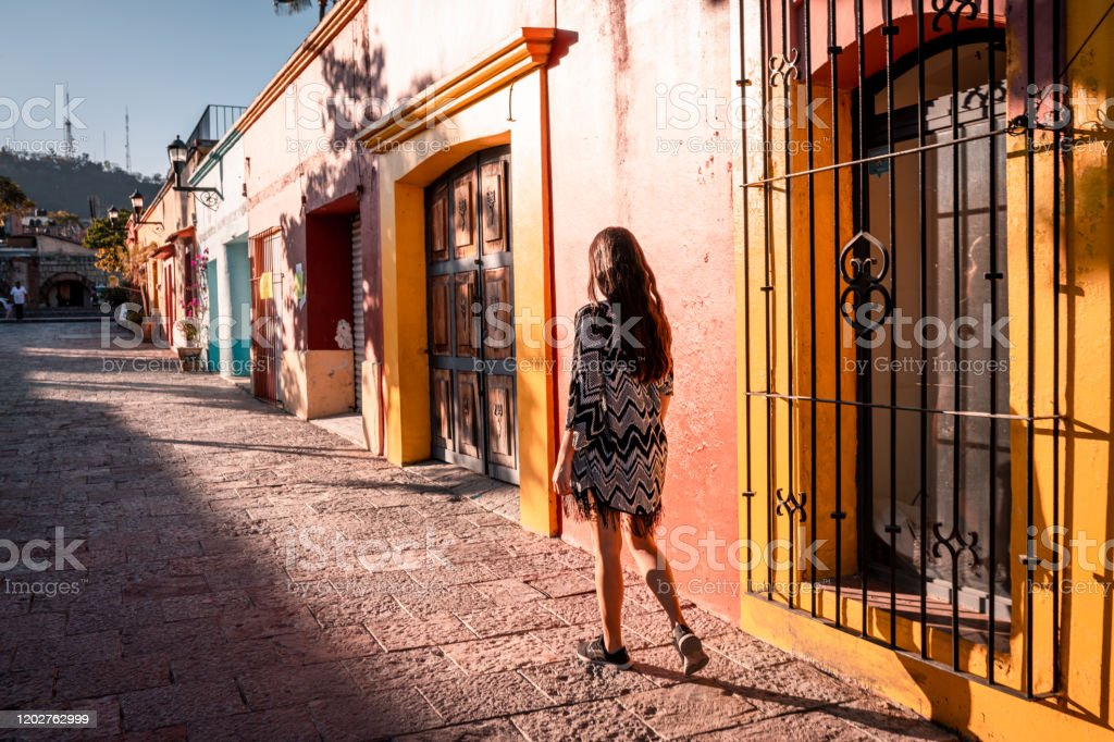 Young woman walking the streets of Oaxaca city Young woman walking the streets of Oaxaca city Adult Stock Photo