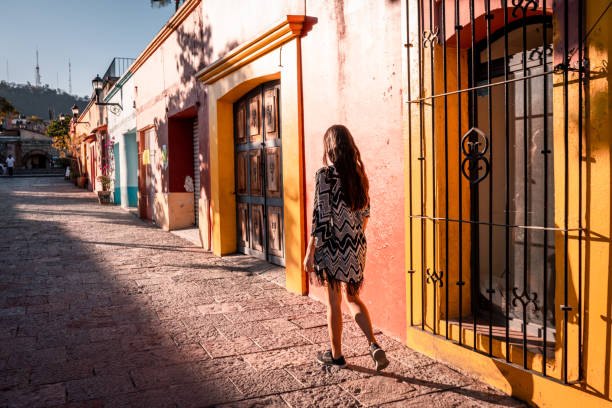 Young woman walking the streets of Oaxaca city stock photo